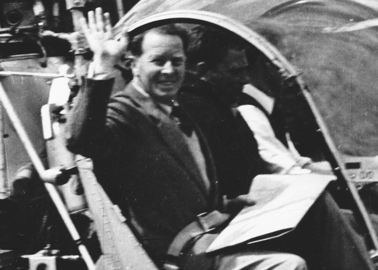Bjarne Dahl waving from a helicopter